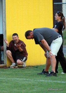 Coach Mike Hines, kneeling with Coach Hodge and Lentz