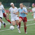 Drianne Raff, Glendale Falcons, in front of the Rock Bridge defense