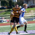 Turner Adams, Kickapoo Chiefs, clears the ball & the defender